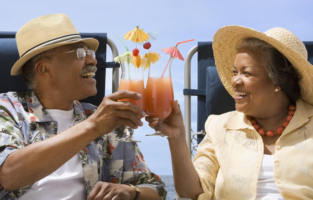 seniors having a drink smiling