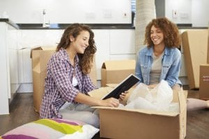 two women packing their stuff to move out