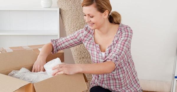A woman unpacking a box